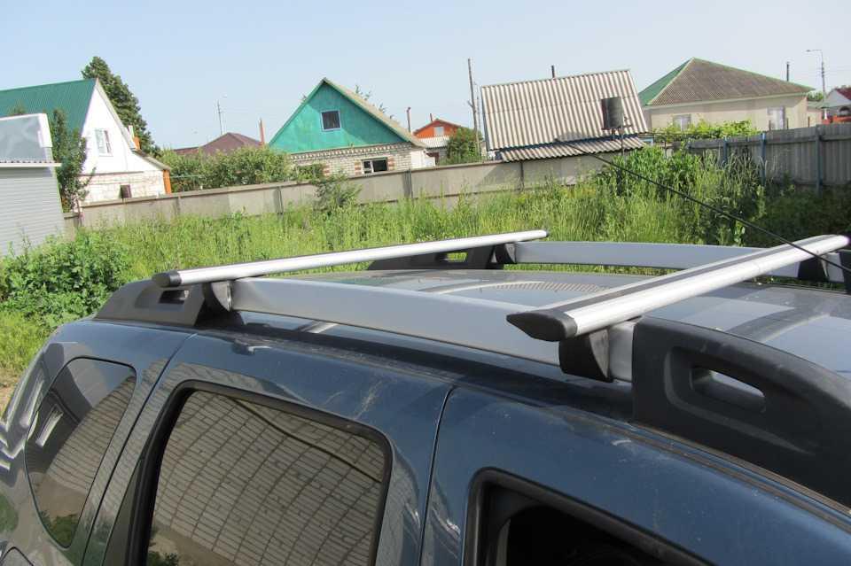 Багажная система Inter для Renault Duster ( Рено Дастер ) / KIA Mohave ( КИА МОХАВ ) / Nissan Pathfinder R51 ( Нисаан пасфаиндер р51 ) на рейлинги с АЭРОдинамическими КРЫЛОвидными алюминиевыми поперечинами